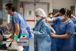 Hospital workers in blue dress in PPE